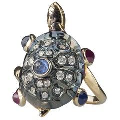18 Karat Gold 0.60 Karat Sapphires 0.35 Karat Ruby Turtle Diamonds Cocktail Ring