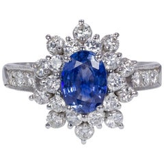 18 Karat Gold, 0.87 Carat Sapphire and 1 Carat Round Cut Diamond Cluster Ring