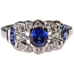 18 Karat Gold 0.93 Carat Art Deco Style Blue Sapphire Diamond Halo Ring