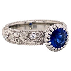 18 Karat Gold 1.09 Carat Blue Sapphire Swirl Pattern Ring with White Diamonds