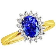 18 Karat Gold 1.28 Carat Natural Oval Blue Sapphire Ring with 16 VS/G Diamonds
