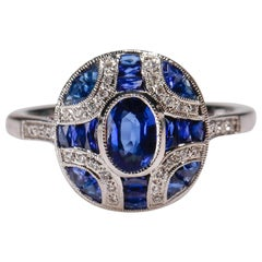 18 Karat White Gold 1.72 Carat Sapphire 0.09 Carat Diamond Art Deco Oval Ring