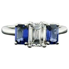 18 Karat Gold 2.45 Carat GIA Emerald Cut Diamond and Sapphire 3 Three Stone Ring