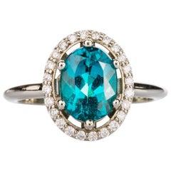 18 Karat Gold 2.47 Carat Indicolite Tourmaline Ring with a White Diamond Halo