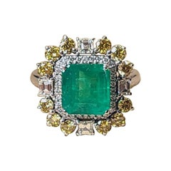 18 Karat Gold, 2.79 Carats, Octagonal Emerald & Yellow Diamonds Cocktail Ring
