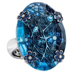 18 Karat Gold 28.00 Carat Oval Blue Topaz Ring with Sapphires and Aquamarine