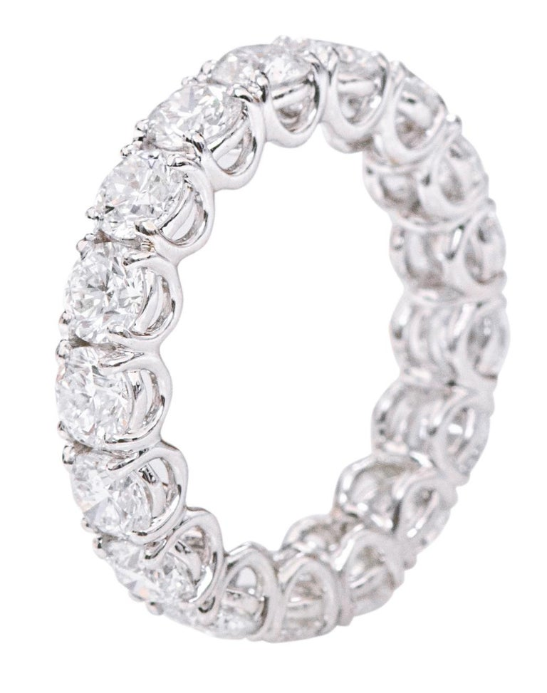 18 Karat Gold 5.79 Carats GIA Certified Brilliant-Cut Diamond Eternity Band Ring   This eternity diamond band is elegantly set with a continuous line of 17 identical sizes and cut of brilliant round 0.34 pointer diamond each GIA certified of E VVS