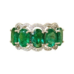 18 Karat Gold, 6.12 Carats Emerald and Diamonds Band Ring