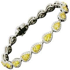 18 Karat Gold 8.51 Carat Fancy Yellow Pear Diamond Halo Tennis Bracelet