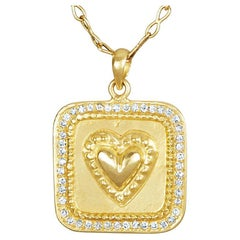 18 Karat Gold Amulet with Raised Sacred Heart with 47 Brilliant Cut Diamonds