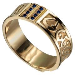18 Karat Gold and 0.15 Carat Sapphire Circles of Eternity Band Ring