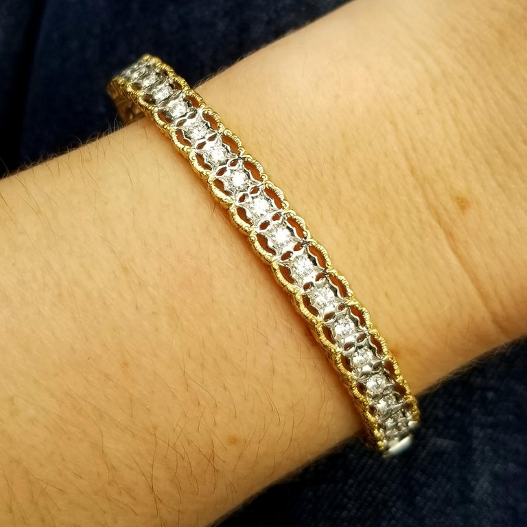 The delicate scalloped lace of the Stefania bangle is finished with richly detailed Florentine engraving, which is a perfect backdrop for the very fine diamonds which span the upper portion of this oval-shaped bangle (1.00ct total).  The shape means