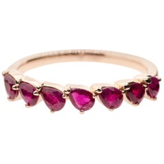 18 Karat Gold and 1.43 Carat Ruby Dancing Pear Eternity Ring by Alessa Jewelry