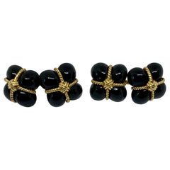"18 Karat Gold and Black Onyx ""Signature"" Cufflinks"