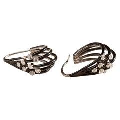 18 Karat Gold and Diamond Earrings Woven with Black Enamel