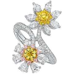 18 Karat Gold and Diamond Ring with 2 GIA Reported Fancy Vivid Yellow Diamonds