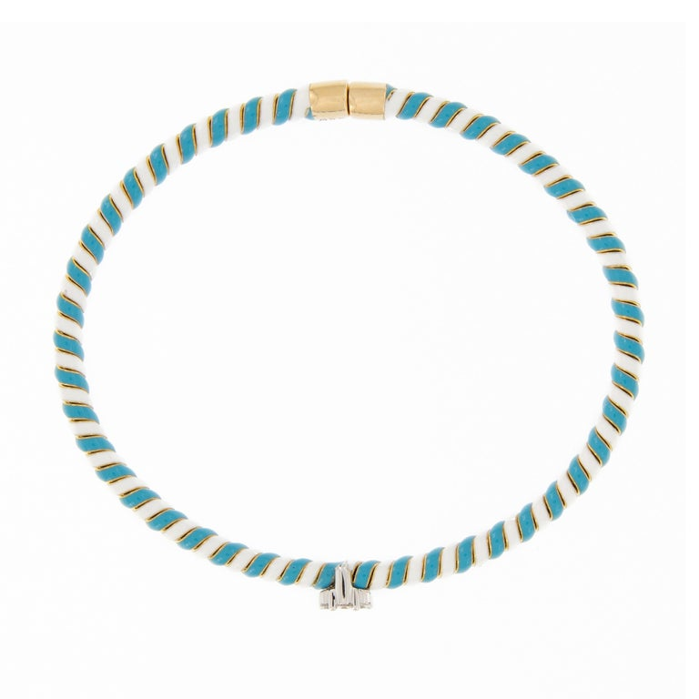 18 Karat gold bracelet features a twisted design of white and turquoise enamel accented with a diamond flower cluster. Bracelet is beautifully handcrafted by Italian artisans, lovely on its own and perfect for stacking. Marked Italy. The inner