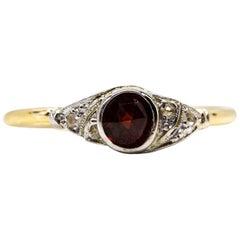 18 Karat Gold and Platinum Garnet and Diamonds Ring