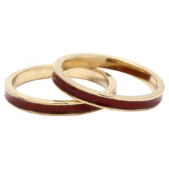 Pair of 18K Yellow Gold and Red Enamel Bands
