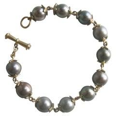 18 Karat Gold and Tahitian Pearl Bracelet