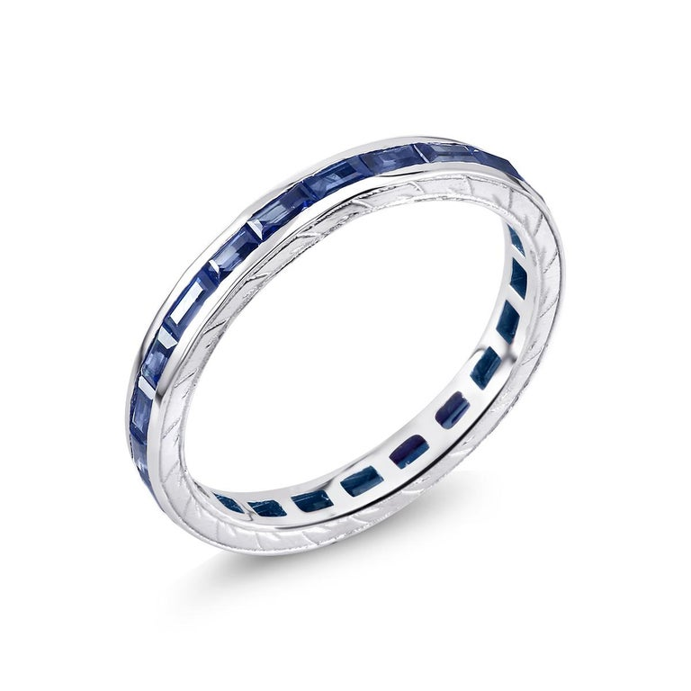 Contemporary Eighteen Karat Gold Baguette Sapphire Eternity Engraved Band Weighing 1.65 Carat For Sale