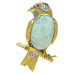 18 Karat Gold Bird on a Branch Brooch with 11.26ct. Opal and .50 Carat Diamonds