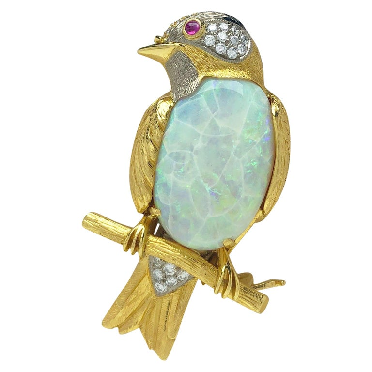 18 Karat Gold Bird on a Branch Brooch with 11.26ct. Opal and .50 Carat Diamonds For Sale