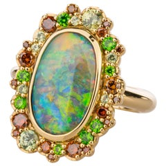 18 Karat Gold Black Opal Ring with Cabernet Diamond and Demantoid Garnet Halo