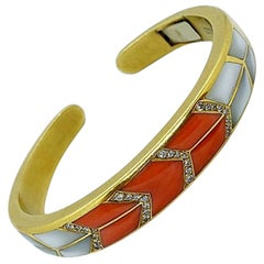 18 Karat Gold Bracelet with Inlaid Coral, Mother of Pearl and .40 Carat Diamonds