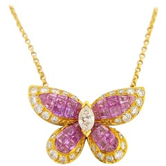 18 Karat Gold Butterfly Pendant Invisibly Set with 5.53 Carat Pink Sapphires