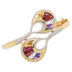 18 Karat Gold Channel Set Baguette Multi-Color Rainbow Diamond Cocktail Bracelet