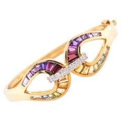18 Karat Gold Channel Set Rainbow Multi-Color Taper Baguette Diamond Bracelet