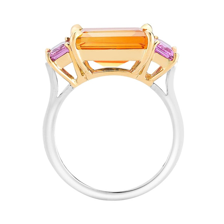 The signature Paolo Costagli three-stone Florentine ring set in 18kt yellow and white gold with an emerald-cut citrine 3.87 carat flanked by emerald-cut pink sapphires 1.22 carat and diamond 0.16 carat detail.  Inspired by the Garden of the Iris,
