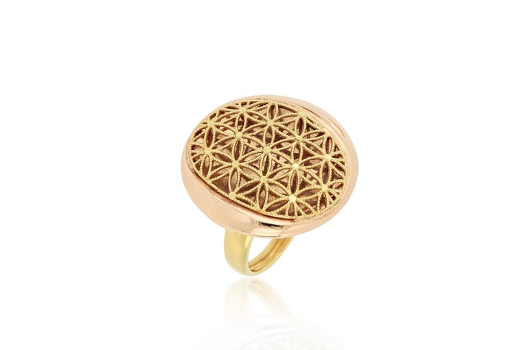 A beautiful 18 karat yellow and rose gold cocktail ring, designed and made in Italy, featuring geometric pattern with textured body . O'Che 1867 is renowned for its high jewellery collections with fabulous designs. Our designs reflect the cultural