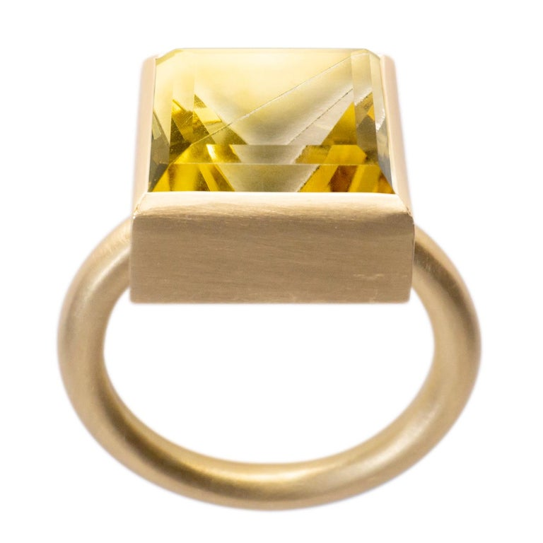 This bold and minimal statement ring is a modern take on the cocktail ring. It features a stone that is fashioned from two natural colored stones that have been fused together then cut and polished as one. When the two characteristics of the