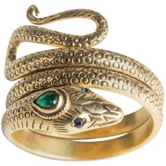 18 Karat Gold Coiled Snake Ring with Emerald and Sapphires