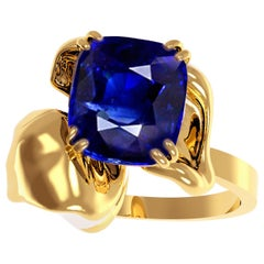 18 Karat Gold Contemporary Engagement Ring with 2.2 Carat Cushion Sapphire