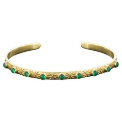 18 Karat Gold Cuff with 9 Cabochon Emeralds and Engraving of Stars & Moons