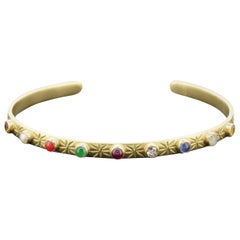 18 Karat Gold Cuff with 9 Cabochon Gems and Engraving of Star and Moons