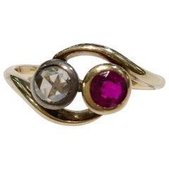 18 Karat Gold Diamond and Ruby Contrarier Ring