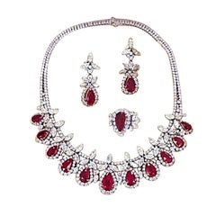 IMPORTANT BURMA Ruby Necklace , Earrings , Ring Set on 18k gold and diamonds