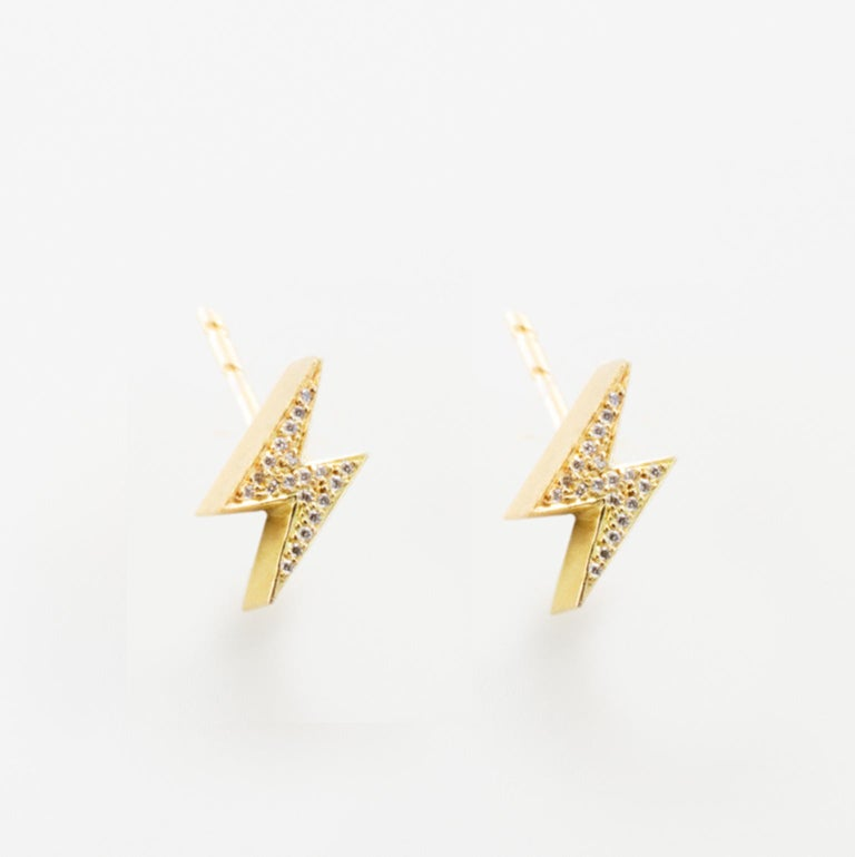 18k Yellow Gold Lightening Bolt Earrings feature two White Diamond pave Lightening Bolt earrings set in 18k yellow gold, with secure round earrings backs.  Sold as a Pair 18k Yellow Gold, White Diamond Pave