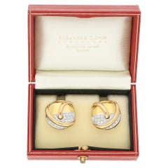Diamond Round Clip Earrings in 18 Karat Yellow and White Gold