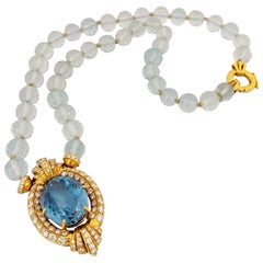 18 Karat Gold Diamonds and 43.50 Carat Blue Topaz Necklace with Aquamarine Beads