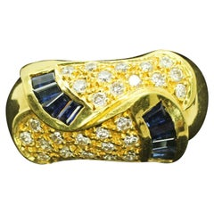 18 Karat Gold Egyptian Inspired Pave Diamond and Tapered Blue Sapphire Ring