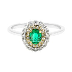 18 Karat Gold Emerald and Diamond Double Cluster Ring