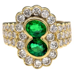 18 Karat Gold Emerald and Diamond Ring