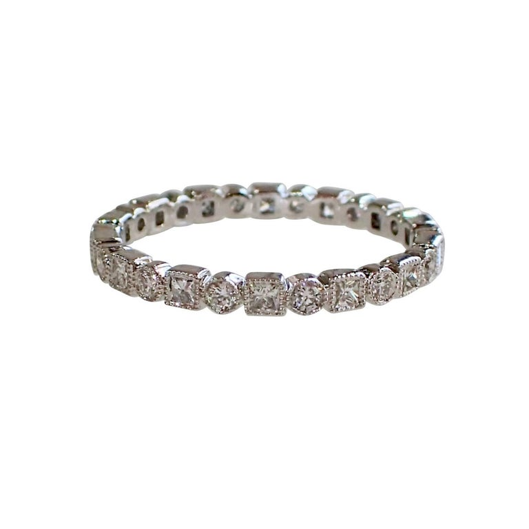 18 Karat Gold Eternity Band with 0.64 Carat of Round and Princess Cut Diamonds