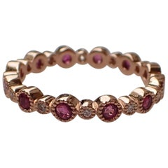 18 Karat Gold Eternity Band with 0.72 Carat of Ruby and 0.12 Carat of Diamond