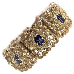 18 Karat Gold French Bracelet with Diamonds, Rubies and Blue Enamel Medallions